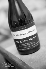 Personalised bottle of Champagne. Kat and Oli's wedding day - photography and videography by Veiled Productions - wedding photography and videography Cambridgeshire