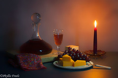 Wine and cheese by candlelight. (Phyllis Freels) Tags: stilllife glass cheese candle wine indoor grapes candlelight tabletop decanter stilllifephotoart phyllisfreels