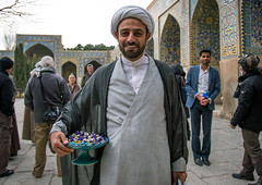 Mullah giving sweets to tourists visiting friday mosque for Public Relations operation filmed by iranian television, Isfahan Province, isfahan, Iran (Eric Lafforgue) Tags: travel people men tourism television smiling horizontal architecture religious outdoors women asia iran propaganda muslim islam persia mosque east communication sweets shia iranian friday press eastern groupofpeople esfahan adultsonly masjid mullah islamic isfahan middleeastern clergy shiite publicrelations cleric ispahan lookingatcamera 5people jameh isfahanprovince shiah mollah masjide colourpicture hispahan irandsc08447