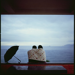Couple in the rain. (Brandotang) Tags: sea people 120 6x6 film rain hongkong couple 120film hasselblad rainy fujifilm medium format rvp 80mm hasselblad500cm rvp100