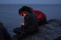 Boy and girl looking at phone at twilight at the lake (Jean-Pierre Dery) Tags: blue boy red people woman lake water girl smiling fun outdoors happy reading student twilight portable couple rocks sitting technology looking bokeh joy cellphone happiness teen together attractive mobilephone sharing teenager casual toothy positive cheerful freetime relaxation youngadult enjoying twopeople carefree sms textmessage sending candlelit teenage textmessaging texting caucasian responding