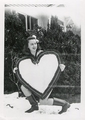 Woman holds a large Valentine's Day heart in the snow (oakenroad) Tags: old winter woman white snow black monochrome vintage found blackwhite day heart antique snapshot valentine photograph valentines vernacular valentinesday foundphotograph