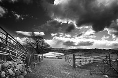 """Into the Valley"" (Idreamofpies) Tags: trees sky white black monochrome weather stone wall wales clouds canon fence river landscape photography gate farming north estuary valley fields pens cony ountyside"