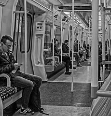 Carriage - District Line Tube (BW) (Fujifilm X70 Compact) (markdbaynham) Tags: city uk people urban bw london monochrome prime fuji candid 28mm capital tube gb fujifilm metropolis fujinon f28 compact x70 londoner londonist 16mp transx fujiuk