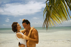 TRO088 (robin-wickens) Tags: trees 2 people men wearing clouds outdoors photography clothing hugging women branches colorphotography couples romance palmtrees beaches males whites recreation females copyspace humanrelationships adults vacations swimwear coasts interactions activewear