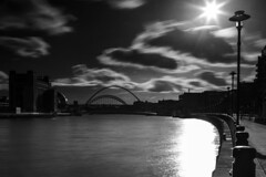 Quayside (ca2cal) Tags: longexposure bridge england sky blackandwhite bw cloud white black reflection water fence river newcastle mono long exposure tripod bridges monotone baltic sage tyne millennium quay gateshead lamppost website quayside tyneandwear 10stop