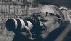 Portrait (Natali Antonovich) Tags: camera brussels portrait monochrome glasses concentration photographer belgium belgique belgie lifestyle photographercamera sweetbrussels magicianfriendcamera