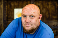 Draft beer seller (Roman Lunin) Tags: red portrait man beer beard eyes manly bald explore toughguy redbeard freckles exploration