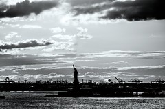 Still standing (Alex Szymanek) Tags: from above city winter light sky bw ny newyork wet water monochrome lines rain silhouette statue clouds standing canon silver dark liberty island see daylight is still day skies quiet view wind time manhattan famous low january away surface an most rainy silence worlds 5d below forever years universe simple far bnw meaning lots witness reflects parallele 2016 markiii hardlight manahattan uneiverses