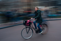 Sense of speed @ Amsterdam (PaulHoo) Tags: city urban holland netherlands girl amsterdam speed cycling movement nikon candid citylife streetphotography panning 2016 streetcandid d700