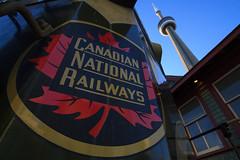 Trains and Towers (Ryan J Gaynor) Tags: railroad toronto ontario canada cn train downtown cntower locomotive canadiannational lowangle ultrawideangle canon7d cn4803