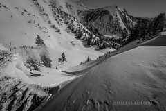 Teton cornice snowmobiling (Jeff Bernhard) Tags: snowboarding hole jackson wyoming zack tetons snowmobile jacksonhole cornice polaris tetonpass zackhahn