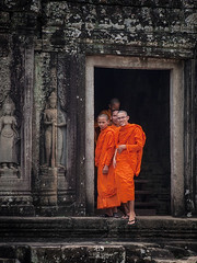 Buddhist monks (Color Odyssey) Tags: travel portrait people orange color heritage history architecture temple cambodia buddhist religion monk buddhism unesco siemreap travelphotography