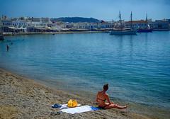 Enjoying the Beach at Mykonos, Greece (` Toshio ') Tags: woman beach water greek harbor europe european ship greece bikini europeanunion mykonos toshio greekisland mykonostown mykonosisland xe2 fujixe2
