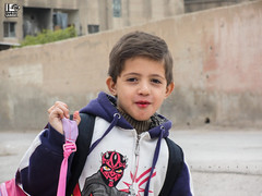 """""""We have been besieged since I was baby, I am going to school right now"""" (Take a look on Syria without propaganda) Tags: school people cute eye sc beautiful beauty smile look childhood danger children happy hope freedom dangerous education child humanity south innocent hard free story human rights revolution future innocence learning syria schoolchildren damascus generation learn pupil regime siege pupils syrian assad pleased سوريا revo schoolchild صعب دمشق خطر مسلم جنوب بسمة دراسة مدرسة أسد مستقبل حصار سوريين"""