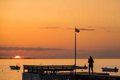 Sunset by the Coast (Infomastern) Tags: sunset sea sky people water boat dock himmel vatten bt hav hllviken solnedgng brygga geolocation mnniska fiskehoddorna geocity camera:make=canon exif:make=canon geocountry geostate exif:lens=efs18200mmf3556is exif:focallength=110mm exif:aperture=63 exif:isospeed=100 camera:model=canoneos760d exif:model=canoneos760d