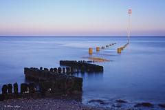 Submerged (Ali Ly) Tags: sea sky beach water sunrise landscape 50mm dawn coast sand pastel tide norfolk groyne heacham nikond810 sigmaart leelittlestopper