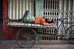 Rickshaw-Van Resting (N A Y E E M) Tags: street morning colors sleep rest today bangladesh carwindow puller chittagong rickshawvan ashkardighirpar