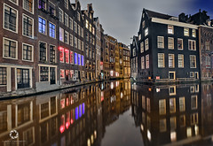 Nights Colors in Amsterdam (Claudio Cantonetti) Tags: street city travel windows light urban holland reflection building colors amsterdam architecture night landscape nikon cityscape place places netherland 2015 d7000 claudiocantonetti