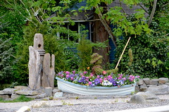 Flowers and Fisherman (Neal D) Tags: flowers boat fisherman topiary bc display surrey crescentbeach planter