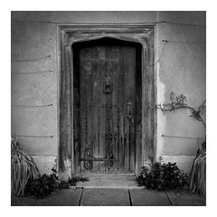 Tudor door (tetleyboy) Tags: door wood blackandwhite square mono oak framed nail olympus tudor nationaltrust stud warwickshire 16thcentury historicalbuilding channelmixer