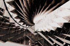 Geometric Cinemascope Swirling Artistic Effect created by Nolan H. Rhodes (nrhodesphotos(the_eye_of_the_moment)) Tags: windows urban bw texture geometric glass monochrome metal architecture dark pattern bright artistic outdoor contemporary creative swirl ironworks cinemascope dsc00848 wwwflickrcomphotostheeyeofthemoment theeyeofthemoment21gmailcom