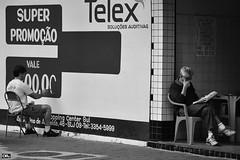 Focus on words (Otaclio Rodrigues) Tags: city cidade urban men wall brasil bar reading newspaper advertisement anncio streetphoto jornal pretoebranco parede pintor oro homens leitura resende wallpainter