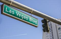 Las Vegas Blvd (Preston Ashton) Tags: vegas blue sky usa trafficlights building sunshine sign america plane airplane lights fly us traffic lasvegas nevada jet sunny northamerica roadsign lasvegasblvd prestonashton