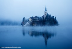Misty Lake Bled (Ian Middleton: Photography) Tags: travel blue autumn vacation mist lake holiday alps building tower history tourism church nature water beautiful fog architecture religious island dawn scenery europe european bell famous scenic eu tourists architectural historic christian touristy stunning bled former christianity popular yugoslavia attraction eec slovenian slovene gorenjska slavic