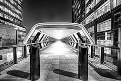 Tunnel of Light Crossrail (Edwinjones) Tags: new city uk travel bridge light england building london architecture modern night photography design starwars fighter cityscape image geometry space sony awesome tube perspective engineering wideangle pic landmark citylights bluehour launch elegant dslr canarywharf iconic hdr highdynamicrange topaz skyscapers crossrail photomatix tonemapped tonemapping dslra700 launchtube adamsplaza crossrailplace