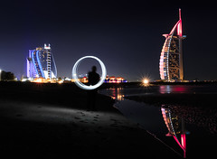 Playing with lights (Amir Shayani) Tags: city travel blue light sea reflection building tower beach water architecture night hotel al colorful long exposure dubai cityscape gulf uae arab jumeira burj dxb