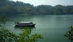 Travel by.... (Sajeeb__) Tags: travel sky lake black tree green water yellow landscape boat ship outdoor vehicle bangladesh