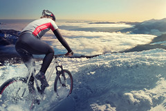 Cyclist in the mountains (agoblin4) Tags: road sunset summer sky panorama mountain man nature bike bicycle wheel sport rock fog stone clouds training back track cyclist view eagle outdoor top altitude smoke extreme helmet young foggy mountainbike peak ukraine adventure equipment explore tired cycle overalls effort win venture rider fatigue epic landscaped