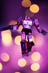 Flying Megatron (mad_airbrush) Tags: pink light canon toy eos colorful purple bokeh flash transformers figure l 5d f2 blitz gel megatron strobe decepticon 135mm miniture 430ex strobistcom strobist revoltech ef135mmf2lusm 580exii 5dmkii yn622c