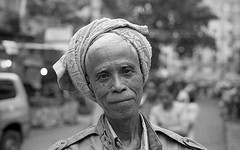 Canon A1 50mm 1.4 Myanmar HP5 sign man (shakmati) Tags: street travel portrait bw black blanco monochrome 35mm canon 50mm retrato yangon burma 14 negro hp5 myanmar a1 blanc ritratto ilford nero mandalay  ssc 135mm