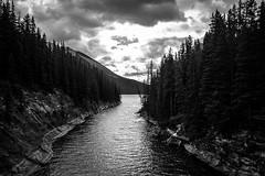 Bridge over settled water (chrisroach) Tags: blackandwhite bw mountain lake canada monochrome clouds landscape rockies blackwhite alberta banff rockymountains anseladams lakeminnewanka canadianrockies