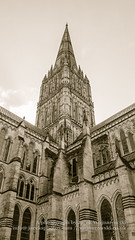 Salisbury Cathedral Tower Low Angle Sepia Tone (Jacek Wojnarowski Photography) Tags: old uk england sculpture building tower vertical architecture facade spring europe cathedral outdoor religion landmark retro salisbury aged christianity spirituality wiltshire sepiatone blackandwhitephotography gothicarchitecture 16x9 religiousbuildings religioussymbol buildingexterior splittoning sepiaphoto englishgothicarchitecture bulitstructure