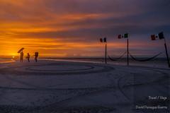 David Paniagua (David Paniagua Guerra) Tags: sunset sky beach silhouette contraluz landscape island atardecer sand playa paisaje flags arena silueta vacations isla banderas roo turistas quintanaroo quintana holbox davidpaniagua
