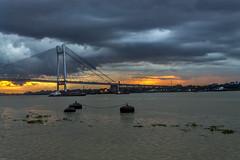 Urban Emotions (sandy_photo) Tags: bridge india rain architecture clouds canon evening monsoon kolkata calcutta ganges rainyseason secondhooghlybridge eos1100d