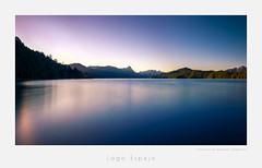 Lago Espejo, Patagonia (MarkRHurn) Tags: longexposure sunset panorama patagonia water argentina landscape atardecer ar style places paisaje environment neuqun purplesky exposicinlarga salidadelsol villalaangostura lagoespejo provinciadeneuquen neuquenprovince lakeespejo