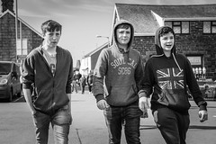 Lads will be Lads (Howie Mudge LRPS) Tags: road street uk houses windows portrait sky people urban blackandwhite bw cars boys monochrome tarmac wales fence walking person mono blackwhite doors lads bokeh walk candid cymru streetphotography teenagers streetlife hoody walkabout casual van unionjack csc gwynedd urbanphotography sweatshirts tywyn micro43 microfourthirds compactsystemcamera micro43mountlenses panasonicdmcgx8 lumixg25f17