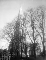Exterior of church surrounded by trees. (National Library of Ireland on The Commons) Tags: trees church killarney railings glassnegative countykerry archivio gothicrevival saintmaryschurch nationallibraryofireland kenmareplace williamatkins locationidentified jamesfranklinfuller fergusoconnor fergusoconnorcollection