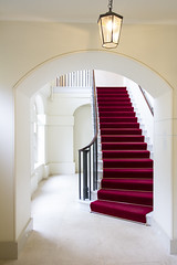 Inside Kensington Palace, red carpeted staircase. (Alma de Angel) Tags: wood uk red england london english stairs carpet entrance royal palace stairwell indoors staircase inside kensington elegant decor royalfamily redcarpeted