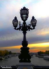 Parisian sunset (Setsukoh) Tags: bridge blue light sunset orange sun paris france monument water lamp yellow vertical seine jaune river lampe soleil frankreich eau wasser ledefrance lumire coucher ile bleu pont sonne lampadaire fleuve verticality luminaire rverbre brochall