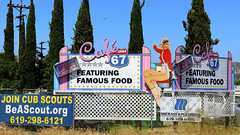 Cafe 67 (Art By Pem Photography: Tao Of The Wandering Eye) Tags: california travel pink blue trees red usa signs color colour colors sign canon fence eos rebel neon colours sandiego letters diner kitsch nopeople billboard socal americana neonsign lettering kitschy roadside chainlinkfence southerncalifornia popculture pinup whimsical sl1 fineartphotography scenicsnotjustlandscapes canoneosrebelsl1
