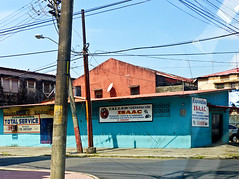photo - Colon, Panama (Jassy-50) Tags: building sign photo isaac panama telephonewires colon colorfularchitecture isaacrepairs