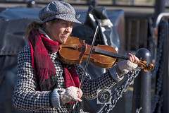On the fiddle (alun.disley@ntlworld.com) Tags: people musician sunlight liverpool bokeh streetphotography musicalinstrument albertdock streetentertainment