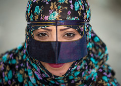 a bandari woman wearing a traditional mask called the burqa at panjshambe bazar thursday market, Hormozgan, Minab, Iran (Eric Lafforgue) Tags: portrait people woman face horizontal closeup outdoors persian clothing asia veil mask iran market muslim islam religion hijab culture persia headshot hidden covered iranian bazaar adults adultsonly oneperson islamic traditionaldress burqa customs ethnicity middleeastern frontview sunni burka chador 20sadult youngadultwoman balouch hormozgan onewomanonly lookingatcamera burqua  bandari  1people  iro thursdaymarket  minab colourpicture  borqe iran034i2908 panjshambe panjshambebazar boregheh