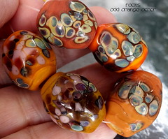 Rocks Odd Orange Ocher (Laura Blanck Openstudio) Tags: blue light orange usa glass leaves coral set garden beads big sand beige rocks colorful aqua warm purple handmade stones eggplant turquoise shapes almond violet fuchsia lavender plum sienna sunny funky jewelry pebbles made odd lilac earthy mango faceted bead bracelets amethyst organic transparent ruby wearable nuggets murano maize lampwork beaded multicolor raku whimsical loose necklaces frit openstudio abstrac neutral asymmetric ocher focals openstudiobeads