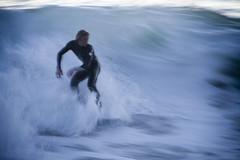 IMG_5685 Skimboarder (Glenn Gilbert) Tags: ocean blur beach water sport evening coast surf waves pacific outdoor surfer skimboard